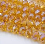 Бусины стекло 3*4мм цв.т.янтарь прозрачный 145шт. с покрытием AB Color Plated